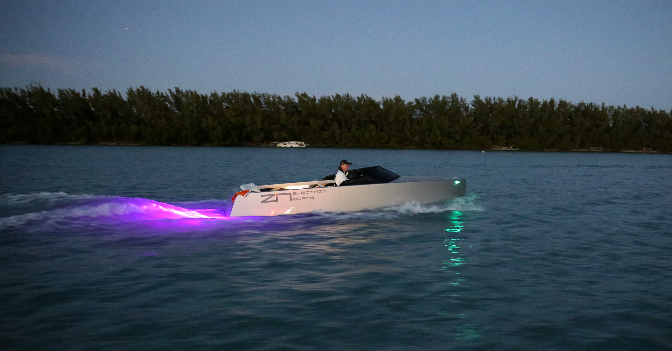 Side view at night of the Z2R Electric boat.