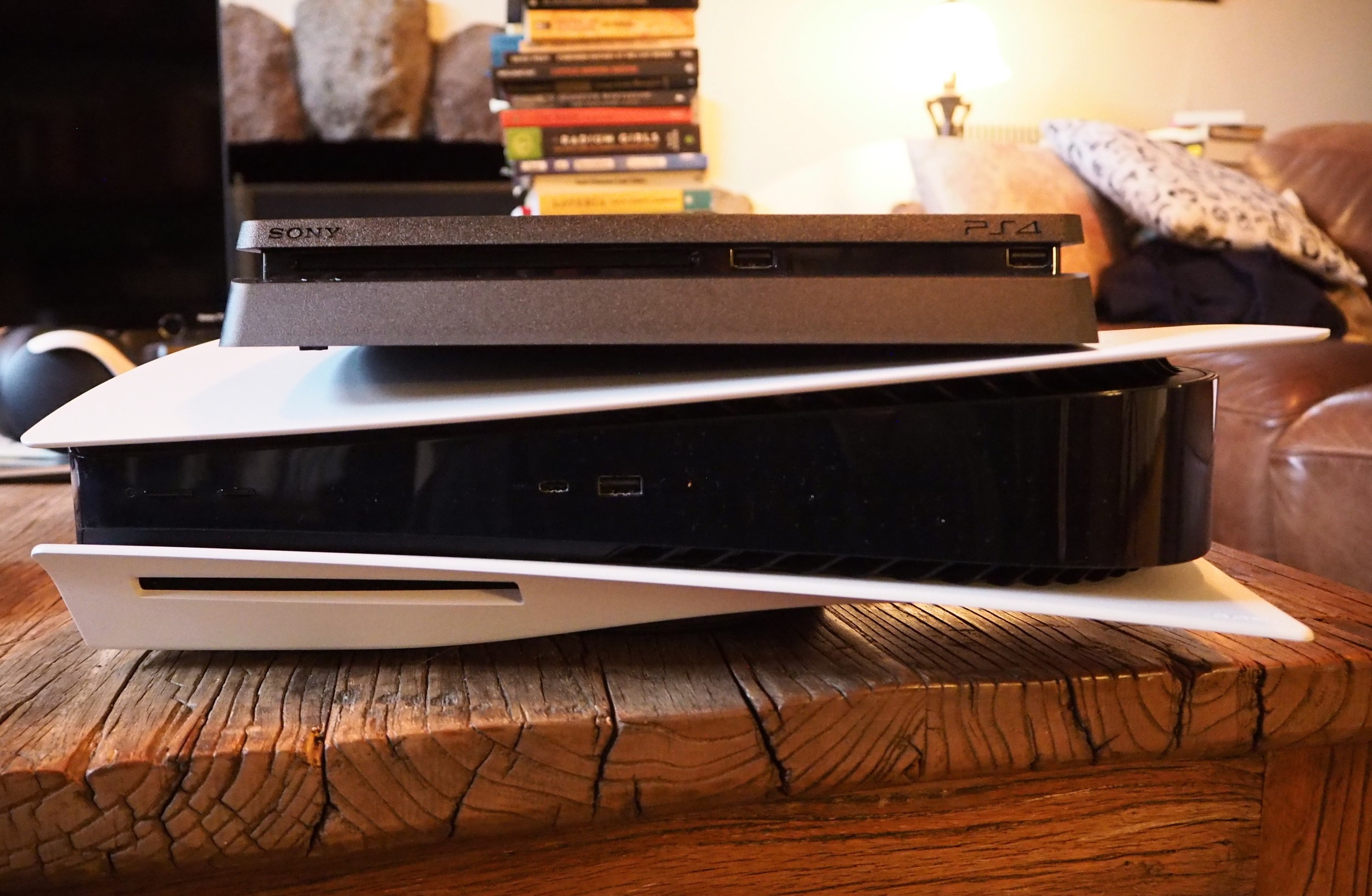 A PS5 console with a PS4 on top