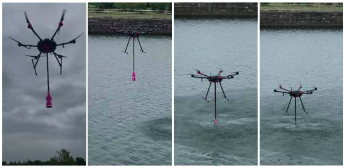 A drone dips a sample container in a river.
